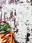 A mixed leaf salad and an orange napkin