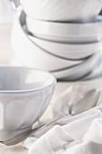 White ceramic bowls, some stacked