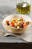 Chickpea salad with tomatoes, feta cheese and mint leaves