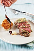 Lamb with a pistachio nut crust with garlic and dark gravy