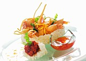 Beer-battered prawns with a sweet and sour dip in a rice nest