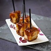 Grilled cubes of pork belly on sticks (Asia)