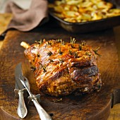 Roasted leg of lamb on a chopping board