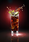 A Cuba Libre splashing out of the glass