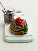 Bread with a lamb burger and red peppers