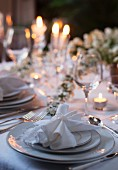 A spring wedding reception table illuminated by candles