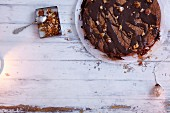 Honey cake with chopped nuts and chocolate glaze