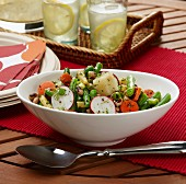 Bean and potato salad with fresh herbs, radishes and carrots