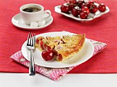 A slice of cherry tart with coffee