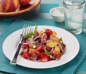Tomato and peach salad with feta cheese and red onions