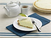 Key Lime Pie with cream and a cup of tea