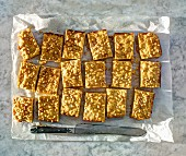 Pine nut bars on a piece of parchment paper