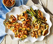 Grilled prawn skewers and spring onions with chermoula