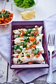 Pollack fillets with tomatoes and parsley