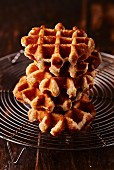 A stack of waffles on a wire rack