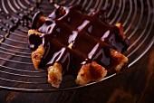 Chocolate-glazed waffles on a wire rack