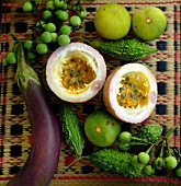 An arrangement of Thai aubergine, bitter gourds, passion fruit and limes