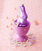 A purple Easter Bunny in an egg cup