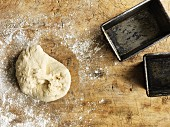 Bread dough and two baking tins