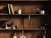 Old kitchen utensils on a wooden shelf