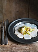 Scallop carpaccio with vegetable salad