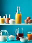 An arrangement of juices, eggs, milk and dairy products