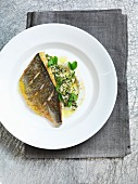 Fried sea bass with couscous, mint, pistachios and cauliflower puree