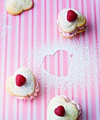 Heart-shaped Valentine's Day whoopie pies filled with raspberry cream