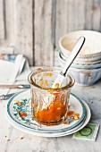 A half-eaten jar of apricot jam