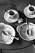 Empty dessert bowls and espresso cups
