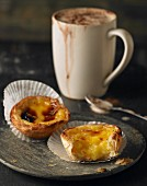 Pastel de Nata (Portuguese custard tarts) with a mug of coffee