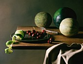 An arrangement of melons, cherries and limes