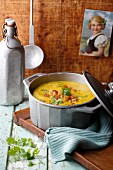 Yellow lentil soup with croutons and coriander