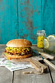 A veggie burger with courgette relish