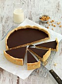 Caramel tart with peanuts and chocolate glaze