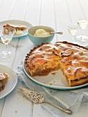 Apple pie, sliced, with cream