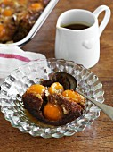 A portion of Sticky Date Pudding with apricots and peaches