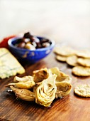 Pickled artichokes, crackers, cheese and olives