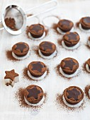 Baileys chocolate tarts dusted with cocoa powder