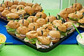 Turkey sandwiches with iceberg lettuce on trays