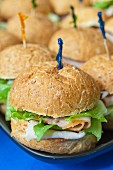 Turkey sandwiches with iceberg lettuce on a tray (close-up)