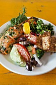 Roasted salmon, with tofu, kale and Greek salad