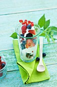 Yoghurt with fresh fruits (strawberries, redcurrants, blackberries, raspberries, blueberries)