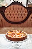 Peach tart on a coffee table