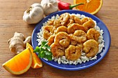 Baked orange prawns on a bed of rice