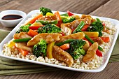 Colourful chicken and vegetable stir fry with rice