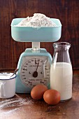 An arrangement of baking ingredients and a pair of kitchen scales