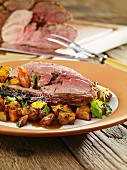 Leg of lamb with potatoes and courgette