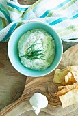 Tzatziki in a bowl with unleavened bread