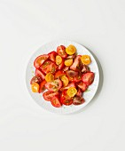 Tomato salad made from different types of red and yellow tomatoes
